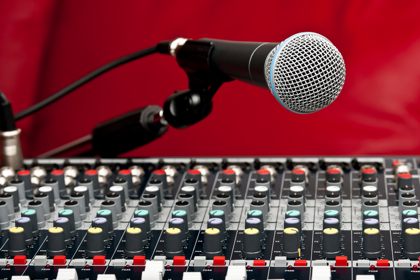 Sound mixing console and microphone in a nightclub.